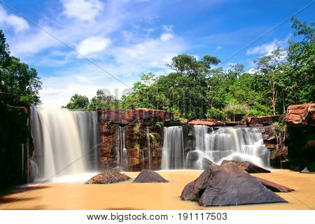 Turbid water stream in early rainy season at Tat Ton Waterfall during sunny day with blue sky Tat Ton National park Chaiyaphum province Thailand
