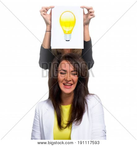 A young girl in a white jacket and a yellow blouse laughs at her idea. Eureka, colleagues, business, education, office concept