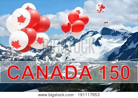 Canada day Maple leaf balloons floating over the Rocky mountains with a Canadian flag in the distance for Canada's 150 Birthday celebration.