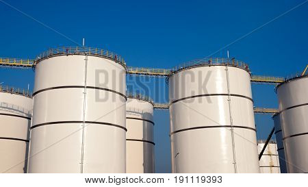 Rowss of large oil storage silo tanks