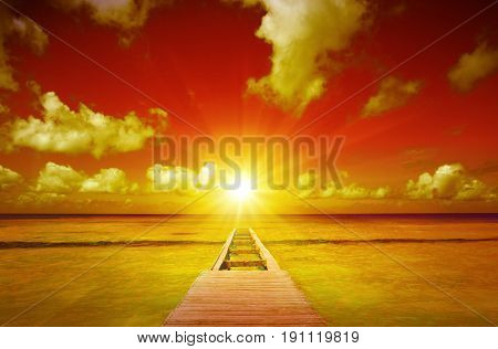 View from the pier and beautiful caribbean sea with sunset.Perspective view of a wooden pier on the caribbean sea.