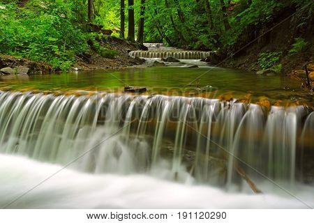 Nice waterfalls on mountain river