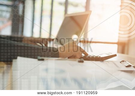 Young Businesswoman Working With Calculator, Business Document And Laptop Computer Notebook In Offic