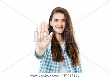 Portrait of a happy smiling woman giving high five to camera isolated over white background