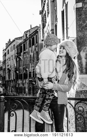 Mother And Daughter Tourists In Venice Looking At Each Other