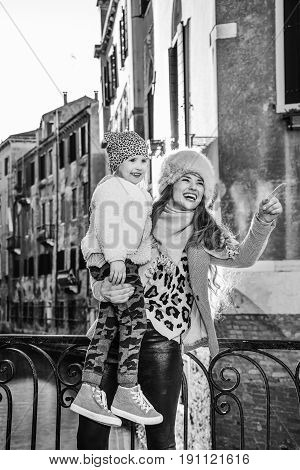 Happy Mother And Child Travellers In Venice, Italy Sightseeing