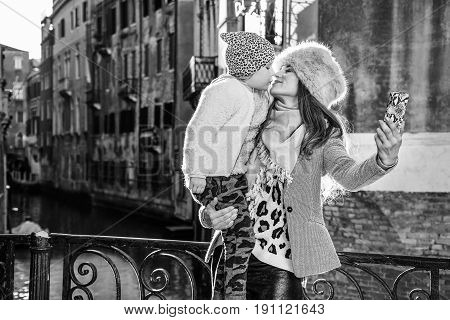 Mother And Daughter Travellers Taking Selfie In Venice, Italy
