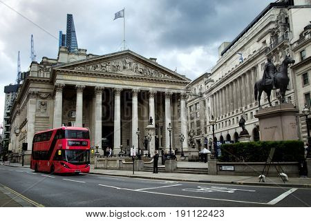 LONDON-UK, 5 june 2017: Red double deck bus in front of the Royal exchange in London.  It is one of the world's oldest stock exchanges in the world and can trace its history back more than 300 years
