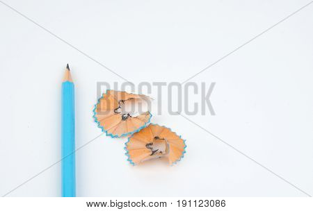 green pencil with cuttings in curve shape isolated on white.