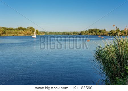 French countryside - Lorraine. A sailboat on the Moselle in the late evening.