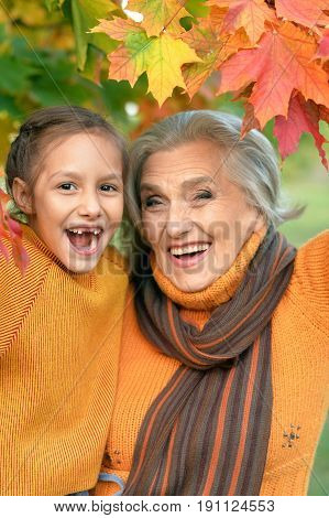 Portrait of a grandmother and granddaughter having fun outdoors