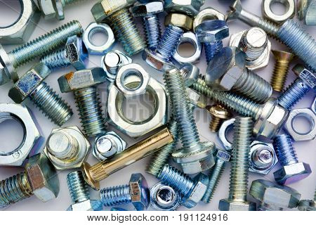 various kind of colored bolts forming a texture
