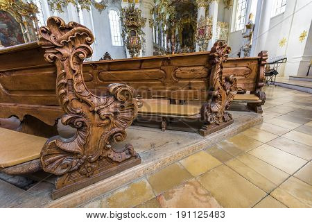 Steingaden, Germany - September 2016: Benches for prayers in White pilgrimage church