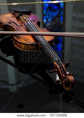 Violin on the grand piano in a concert hall close-up