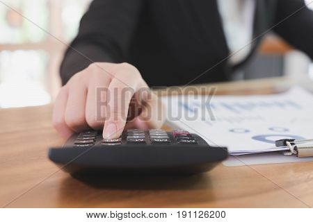 Businesswoman Using Calculator At Workplace. Young Female Entrepreneur Woman Working With Business D