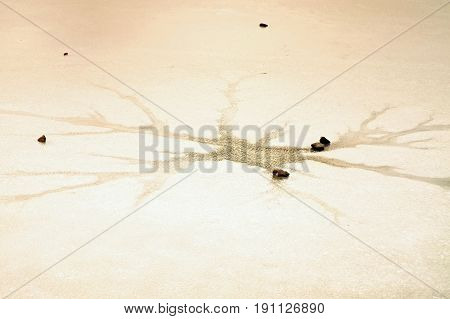 Cracks And Hole In Ice On Pond, Dark Ice In Hole And Stone Around.