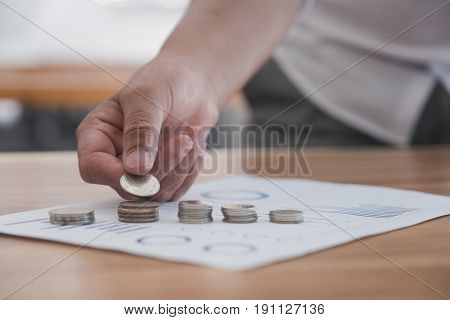 Businessman Put Coins On Money Stack. Business Finance And Investment