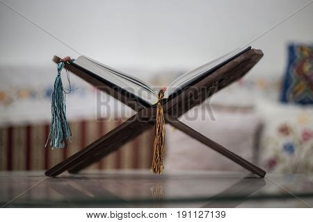 Quran-holy book of Muslims an open book on a stand with rosary