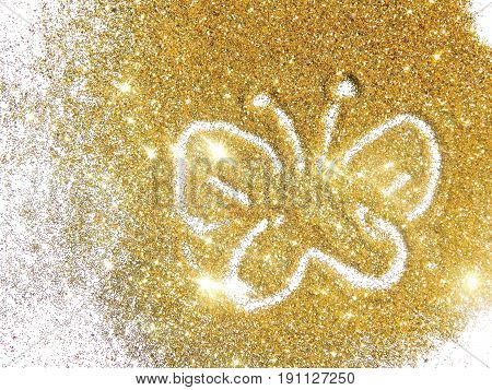 Butterfly on the golden glitter.  Beautiful background for your design. Photographic filters were used, nostalgic colors