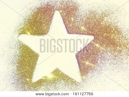 Star on the golden glitter.  Beautiful background for your design. Photographic filters were used, nostalgic colors