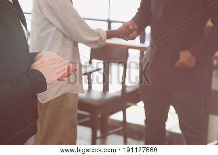 Young Businessman Applauding To Speaker After Seminar Presentation. Business Partners Clapping Hands