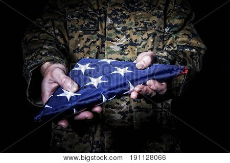 american army soldier with flag fold old glory