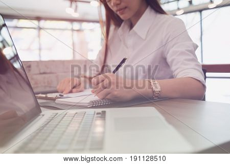 Businesswoman Analyze Market Report At Workplace. Young Female Entrepreneur Woman Working With Busin