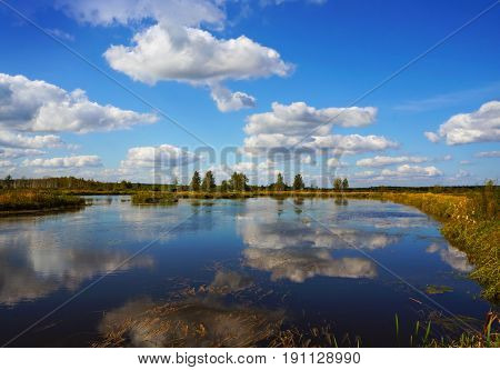 Summer landscape, river and clouds in scenery