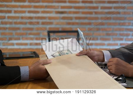 Businessman Receiving Envelope With Money. Man Giving Contract And Cash (banknote) To Business Peopl