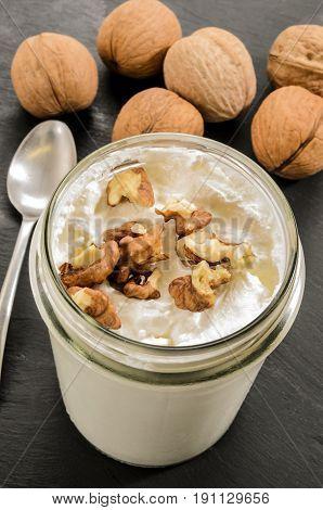 homemade fresh yogurt with walnut in a glass
