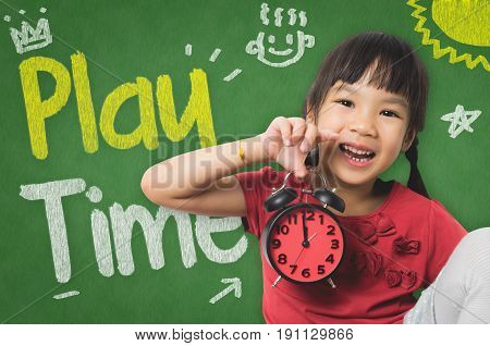 Little girl is holding a clock ready for playtime