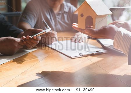 Realtor Talk With His Clients.  Real Estate Agent Have A Deal With A Couple. House Developer And Cus