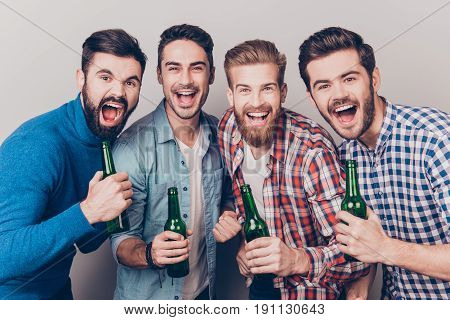 Men`s Club. Four Crazy Friends Guys Are Screaming With Bottles In Hands, All In Casual Shirts, Isola