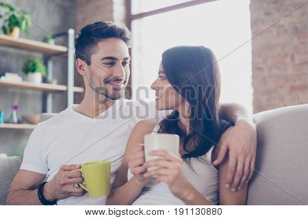 True Love. Breakfast At The Weekend Together. Beautiful Couple In Casual Outfit Is Sitting On Sofa A