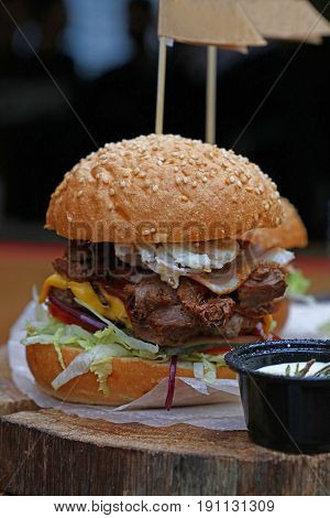 Big Burger With Pulled Pork Meat On Wooden Cut