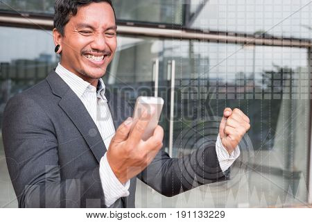 Successful Business Man Checking Cellphone Message And Gesturing With Happiness And Gladness Outside