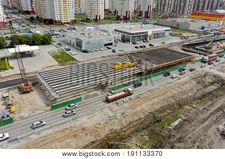 Tyumen, Russia - June 1, 2017: Construction of two-level outcome on bypass road on Fedyuninskogo and Permyakova streets intersection