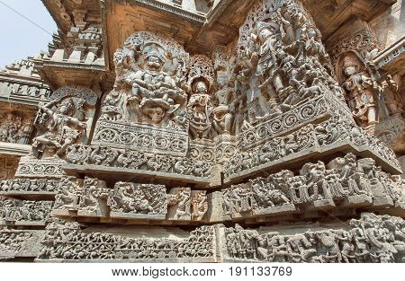 Fantastic Indian architecture in ancient temples of Halebidu with carved Narasimha Lord and other Hindu gods. 12th century Hoysaleshwara temple, India