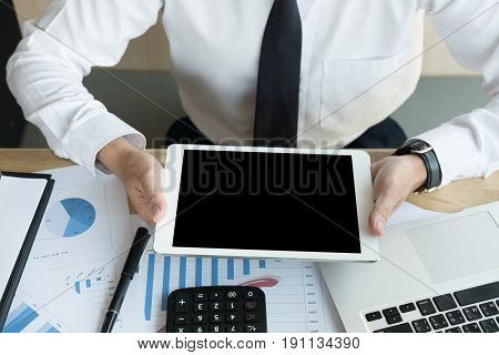 Businessman Using A Digital Tablet In Office. Young Male Start Up Entrepreneur Working On Touch Pad