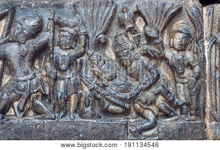 Sexual activity of lord Shiva and his wife Parvati, on sculptured wall of 12th centur Hindu Hoysaleshwara temple in Halebidu, India.