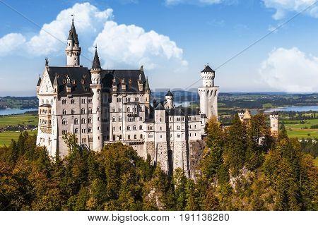 Neuschwanstein castle autumn view on a sunny day. Bavaria, Germany