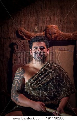 NORTH ISLAND, NEW ZEALAND- MAY 17, 2017: Close up of a Maori leader man with traditionally tatooed face in traditional dress at Maori Culture, Tamaki Cultural Village, Rotorua, New Zealand.