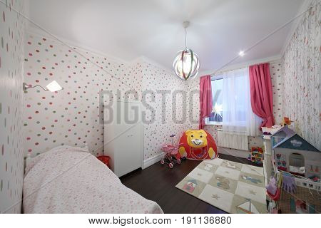 MOSCOW - JAN 20, 2017: Interior of a childrens room (with property release) for a girl with a bed, wardrobe and play area