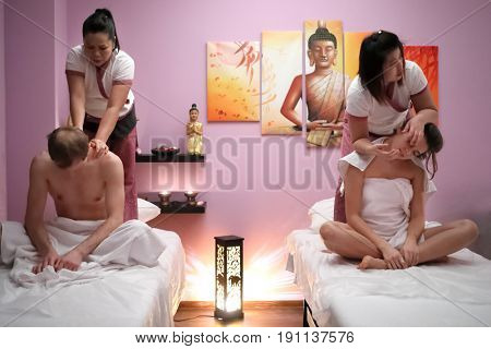 MOSCOW - JAN 30, 2017: Two masseurs (with model releases) make spa treatments for men and women (with model releases) in the spa salon