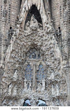 BARCELONA SPAIN - OCTOBER 07 2015: Detail of Nativity facade of Sagrada Familia church in Barcelona Spain. Designed by Antoni Gaudi.