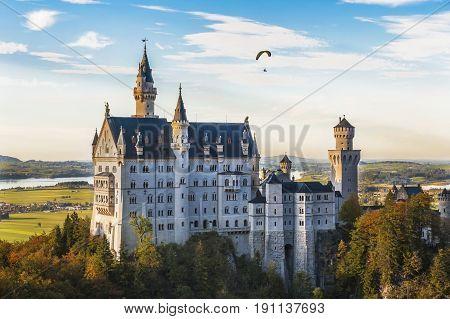 Paragliding over Neuschwanstein castle . Bavaria, Germany
