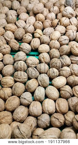 Close up food background with Walnuts in nutshell