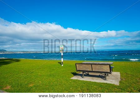 Beautiful view of lovely Lake Taupo with mountains an city in the background at spring, North Island of New Zealand with beautiful blue sky.