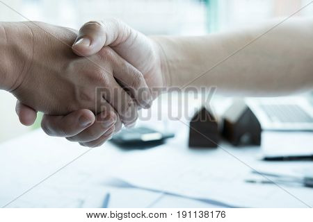 Architect And Customer Shaking Hands At Workplace. Engineer Handshaking With Partner For Successful