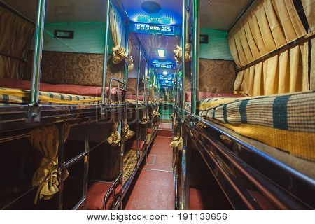 BANGALORE, INDIA - FEB 10, 2017: Empty interior of sleeper bus for tourists and other passengers on February 10, 2017. Capital of state Karnataka has a popul. of 8.42 million